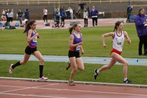 Kate Gallagher (340) and Sarah Calvert (334) make ready for the final lap in the senior 1500m as they gained maximum points