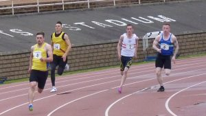 Peter Muirhead (4) on the way to 200 metre B victory