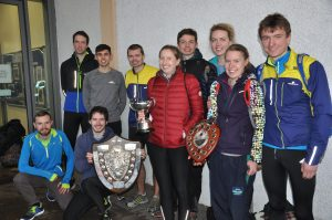 Team members with their trophies