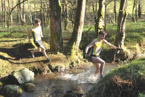 Lewis Dow leads Finlay Muir across the burn cross but it was Finlay who came out on top