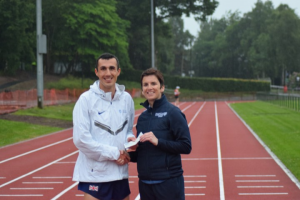 Ben Greenwood receives his prize from Cathy Gallagher