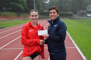 Mhairi MacLennan receives her prize from Cathy Gallagher